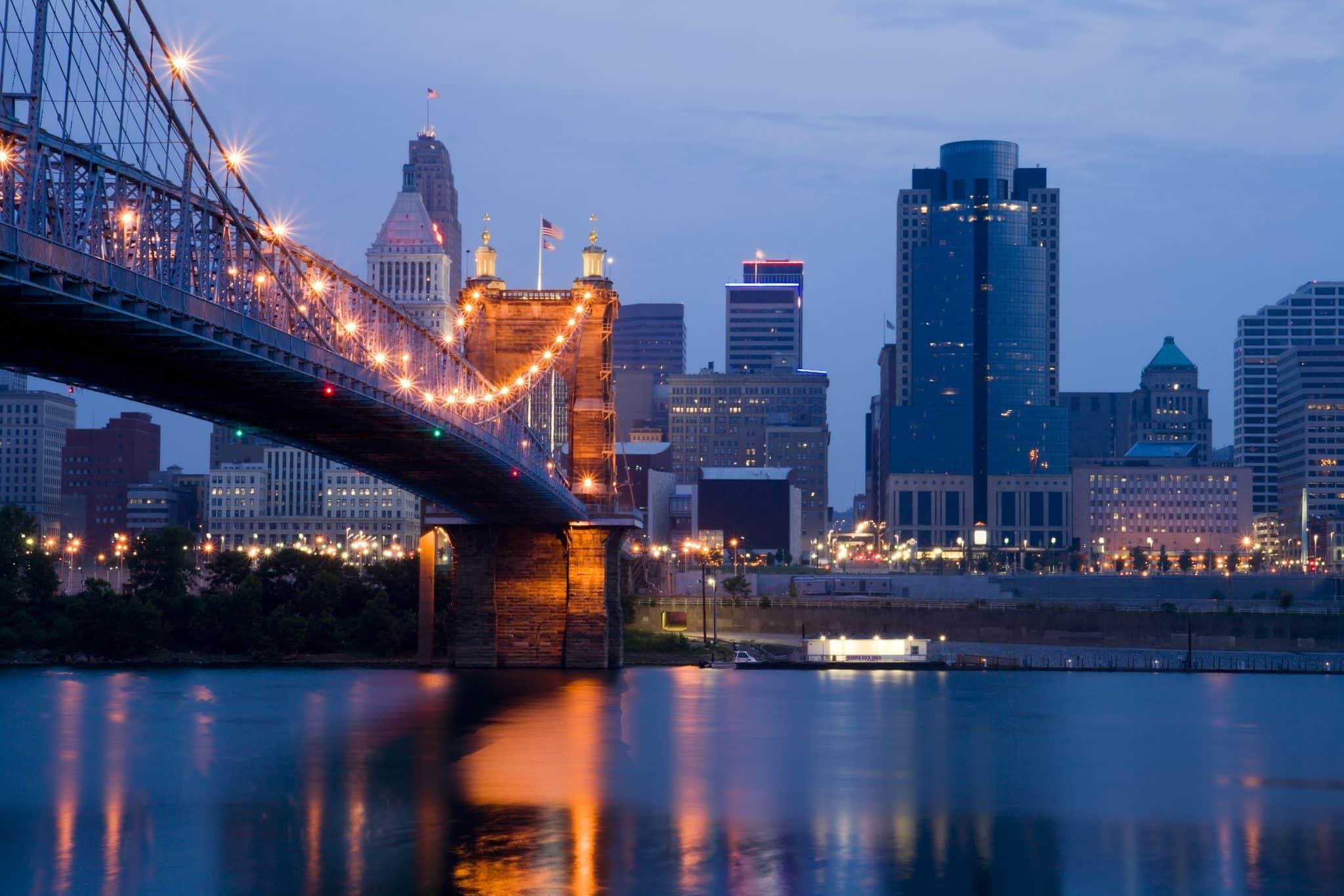 Cincinnati skyline and Roebling Suspension Bridge shortly before sunrise.